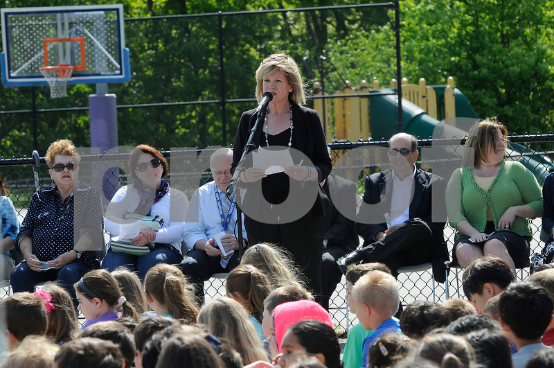 TIM JEAN/Staff photo  Pamela Lathrop, Principal of High Plain welcomes guests to the ground breaking ceremony at High Plain Elementary/Wood Hill Middle for the accessibility ramp project to the athletic fields.  5/23/18