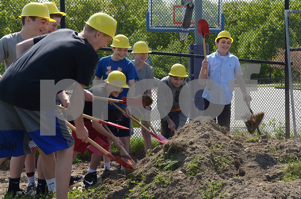 TIM JEAN/Staff photo  Liam Flanagan, right, and his friends and fellow student ambassadors from Wood Hill Middle toss dirt into the air during a ground breaking ceremony at High Plain Elementary/Wood Hill Middle for the accessibility ramp project to the athletic fields. Pictured with Liam Flanagan are Christian Yianopoulos, Patrick Cote, Michael Andelman, Ryan Ehrgott, Brian Hnat, Jack Trash, Peter McLaughlin and Jack Van Buren.   5/23/18