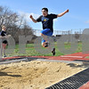 TIM JEAN/Staff photo<br /> <br /> <br /> Andover's Danny Koo competes in the long jump during a unified track meet against North Middlesex Regional. The event was held in the Lovely Stadium at Andover High School. 5/1/18