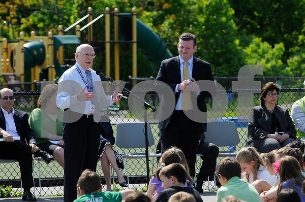 TIM JEAN/Staff photo  Dr. Sheldon Berman, Superintendent, left, and Andrew Flanagan, Town Manager speak during a ground breaking ceremony at High Plain Elementary/Wood Hill Middle for the accessibility ramp project to the athletic fields.  5/23/18