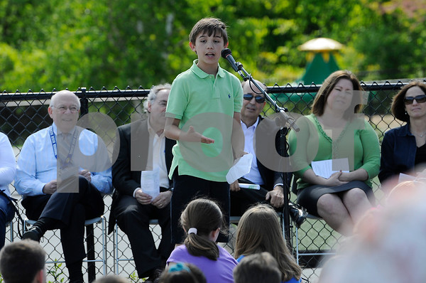 TIM JEAN/Staff photo  Colin Flanagan, High Plain Elementary student speaker makes a point during a ground breaking ceremony for the accessibility ramp project to the athletic fields.  5/23/18