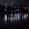 TIM JEAN/Staff photo <br /> <br /> Students use cell phones as the fall captains are introduced in the dark, during a school spirit rally in the Dunn Gymnasium at Andover High School. 11/27/19