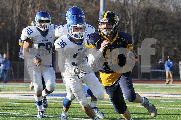 TIM JEAN/Staff photo<br /> <br /> Andover running back Erik Aulbach gains the edge and runs for a short gain as Methuen's Braeden Carter (36) Anthony Castro (17) and Ethan Ayala (68) force him out of bounds during the D1 North playoff football game. Andover defeated Methuen 40-12.     11/2/19