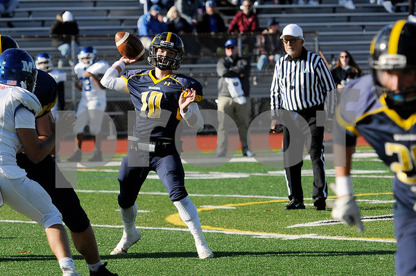 TIM JEAN/Staff photo<br /> <br /> Andover quarterback Scott Brown throws a pass against Methuen during the D1 North playoff football game. Andover defeated Methuen 40-12.     11/2/19