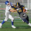 TIM JEAN/Staff photo<br /> <br /> Andover quarterback Scott Brown scrambles for a big gain as Methuen's Nic Mathieu forces him out of bounds during the D1 North playoff football game. Andover defeated Methuen 40-12.     11/2/19