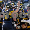 TIM JEAN/Staff photo<br /> <br /> In center, Andover running back Joshua Ramos, with ball, is swarmed by his teammates after scoring his second touchdown against Methuen during the D1 North playoff football game. Andover defeated Methuen 40-12. Ramos had four touchdowns on the day.    11/2/19