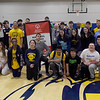 TIM JEAN/Staff photo <br /> <br /> Unified sports athletes with school officials gather as they and the school received a national recognition from the Special Olympics as a Unified Champion School during a school spirit rally in the Dunn Gymnasium at Andover High School.      11/27/19