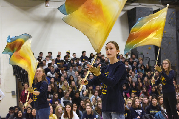 TIM JEAN/Staff photo <br /> <br /> Allison Regnant, center, of the Andover High School Marching Band Color Guard performs during a school spirit rally in the Dunn Gymnasium at Andover High School. 11/27/19