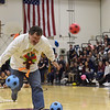 TIM JEAN/Staff photo <br /> <br /> Andover High School Principal Philip Conrad tries to avoid being hit while running through the turkey shoot obstacle corse during a school spirit rally in the Dunn Gymnasium at Andover High School. 11/27/19