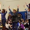 TIM JEAN/Staff photo <br /> <br /> Stephanie Hand, center, performs with her fellow teachers in a flash mob during a school spirit rally in the Dunn Gymnasium at Andover High School. 11/27/19