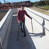 TIM JEAN/Staff photo<br /> <br /> Liam Flanagan, 13, walks down the ramp towards a slide built into the access ramp as town and school officials celebrate the grand opening of the High Plain Elementary and Wood Hill Middle School Athletic Field Accessibility Project. The ramp will connect the schools' basketball court to the lower soccer fields.  10/5/18