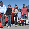 TIM JEAN/Staff photo<br /> <br /> The Flanagan Family from left to right, Leo, Colin, 11, Carlene Bell-Flanagan, Aidan, 10, and Liam, 13, cut the ceremonially ribbon as town and school officials celebrate the grand opening of the High Plain Elementary and Wood Hill Middle School Athletic Field Accessibility Project. The ramp will connect the schools' basketball court to the lower soccer fields.  10/5/18