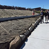 TIM JEAN/Staff photo<br /> <br /> Andover town and school officials walk along the access ramp as they celebrate the grand opening of the High Plain Elementary and Wood Hill Middle School Athletic Field Accessibility Project. The ramp will connect the schools' basketball court to the lower soccer fields.  10/5/18