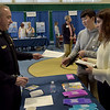 TIM JEAN/Staff photo<br /> <br /> Andover High School students Samira Sayan, right, and Matthew Lem, both seniors, listen to Andover Police Sgt. Steve Gerroir during the 3rd Annual Credit for Life Fair held in the Richard J. Collins Field House.    4/9/19
