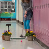AMANDA SABGA/Staff photo<br /> <br /> Kaylee Ryan, 13, take a shot during an indoor mini golf fundraiser at the West Elementary School in Andover. <br /> <br /> 4/6/19