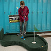 AMANDA SABGA/Staff photo<br /> <br /> Robert Grinnell, 8, puts the ball during an indoor mini golf fundraiser at the West Elementary School in Andover. <br /> <br /> 4/6/19