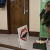AMANDA SABGA/Staff photo<br /> <br /> Keira Conley, 7, lines up her shot during an indoor mini golf fundraiser at the West Elementary School in Andover. <br /> <br /> 4/6/19
