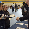 TIM JEAN/Staff photo<br /> <br /> Andover High School students Kathryn Oberg, let, and Zoie Haskell, both seniors listen to Pete Johnston, of the Savings Bank during the 3rd Annual Credit for Life Fair held in the Richard J. Collins Field House.    4/9/19