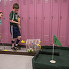 AMANDA SABGA/Staff photo<br /> <br /> Siblings Isabel, 6, and Colin Killilea, 8, play the first hole during an indoor mini golf fundraiser at the West Elementary School in Andover. <br /> <br /> 4/6/19