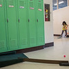 AMANDA SABGA/Staff photo<br /> <br /> Anika Dhingra, 7, takes a shot during an indoor mini golf fundraiser at the West Elementary School in Andover. <br /> <br /> 4/6/19