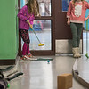 AMANDA SABGA/Staff photo<br /> <br /> Mia Barbagallo takes her first shot as Leah Tucci looks on during an indoor mini golf fundraiser at the West Elementary School in Andover. <br /> <br /> 4/6/19