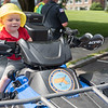 AMANDA SABGA/Staff photo<br /> <br /> Vincent Richard 2, of Tewksbury tries out an ATV during truck day at The Park in Andover.<br /> <br /> 8/1/19