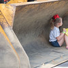 AMANDA SABGA/Staff photo<br /> <br /> Cameron Kivela, 5, of Boxford sits in the bucket of a front end loader during truck day at The Park in Andover.<br /> <br /> 8/1/19
