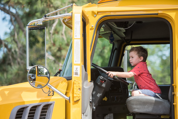 AMANDA SABGA/Staff photo<br /> <br /> Julian Farhadian, 3, of Andover beeps the horn of a large truck during truck day at The Park in Andover.<br /> <br /> 8/1/19