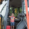 AMANDA SABGA/Staff photo<br /> <br /> Joey Guilmartin, 2, of Andover poses for a photo during truck day at The Park in Andover.<br /> <br /> 8/1/19