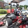 AMANDA SABGA/Staff photo<br /> <br /> Grady Schnips, 4, of Andover tries out a large lawn mower during truck day at The Park in Andover.<br /> <br /> 8/1/19