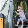 AMANDA SABGA/Staff photo<br /> <br /> Zoe Crain, 2, of Wakefield test drives a fork lift during truck day at The Park in Andover.<br /> <br /> 8/1/19