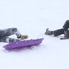 MIKE SPRINGER/Staff photo<br /> Alex Flaherty, left, and Kasey Cosentino, both 12, wipe out Monday while sledding down the hill at Andover High School.<br /> 12/2/2019
