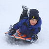 MIKE SPRINGER/Staff photo<br /> Five-year-old Deacon Flanders rides his sled down the hill Monday at Andover High School.<br /> 12/2/2019