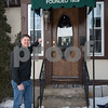 AMANDA SABGA/Staff photo<br /> <br /> John Hugo owner of the Andover Bookstore poses for a photo at the entrance to the store which is the oldest independent bookstore in the country.<br /> <br /> 2/1/19