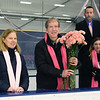 CARL RUSSO/Staff photo. TOWNSMAN: Colleen Ritzer's parents, Peggie and Tom were presented pink carnations by both hockey teams before the start of the game. <br /> <br /> The annual Colleen Ritzer memorial hockey game between Andover high and Beverly/Danvers was played Wednesday night at the Raymond Bourque arena at Endicott College. The game benefits the Colleen Ritzer Memorial Scholarship Fund. Colleen Ritzer of Andover, a Danvers high school teacher was murdered in 2013 by her student. 1/9/2019