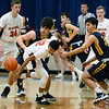 CARL RUSSO/Staff photo Andover captain, Emmett Kim, right, and teammate Michael Slayton fight for the loose ball with Central's Xavier Mc Kenzie. Andover defeated Central Catholic 71-62 in boys basketball. 1/11/2019
