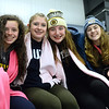 CARL RUSSO/Staff photo. TOWNSMAN: Andover high students, from left, Lindsey Parziale, sophomore, Jacqui Haney, freshman, Grace Kiley, sophomore and Molly O'Handley, sophomore wore pink scarfs in memory of Colleen during the game. <br /> <br /> The annual Colleen Ritzer memorial hockey game between Andover high and Beverly/Danvers was played Wednesday night at the Raymond Bourque arena at Endicott College. The game benefits the Colleen Ritzer Memorial Scholarship Fund. Colleen Ritzer of Andover, a Danvers high school teacher was murdered in 2013 by her student. 1/9/2019
