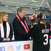 CARL RUSSO/Staff photo. TOWNSMAN: Colleen Ritzer's parents, Peggie and Tom accept pink carnations from Andover high senior, Katie Adams. Both teams presented the flowers to the Ritzers before the start of the game. <br /> <br /> The annual Colleen Ritzer memorial hockey game between Andover high and Beverly/Danvers was played Wednesday night at the Raymond Bourque arena at Endicott College. The game benefits the Colleen Ritzer Memorial Scholarship Fund. <br /> Colleen Ritzer of Andover, a Danvers high school teacher was murdered in 2013 by her student. 1/9/2019