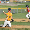 CARL RUSSO/Staff photo Andover American pitcher, Ryan Jaillet goes down to make the stop and the throw to first base for the out.  <br /> <br /> North Andover defeated Andover American 9-8 in Little League baseball action at the Carl Thomas field in North Andover Friday night.  6/28/2019