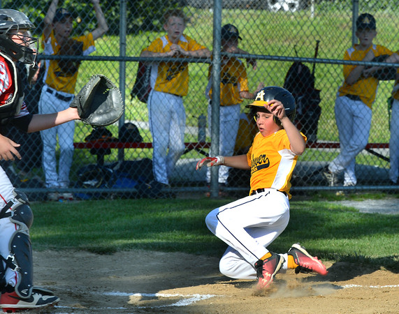 CARL RUSSO/Staff photo Andover American Simon Green slides hard into home plate to score the team's first run of the game.  <br /> <br /> North Andover defeated Andover American 9-8 in Little League baseball action at the Carl Thomas field in North Andover Friday night.  6/28/2019
