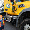 CARL RUSSO/Staff photo. Dressed for the occasion,  Mason Richards, 5 of Andover gives a wink and thumbs up after visiting a large DPW dump truck. <br /> <br /> The Friends of the Andover Memorial Hall Library and the town's fire, police and DPW  departments sponsored the annual vehicle night on Tuesday (7/16). The library parking lot was converted into a display of large DPW and fire trucks and a variety of police vehicles for kids to view, climb inside and sit behind the wheel. Gifts were given out to the kids by the Library, police and fire departments. 7/16/2019