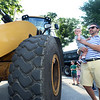 CARL RUSSO/Staff photo. Ross Maguire and his son Charlie, 1 take a closer look at a DPW front end loader.  <br /> <br /> The Friends of the Andover Memorial Hall Library and the town's fire, police and DPW  departments sponsored the annual vehicle night on Tuesday (7/16). The library parking lot was converted into a display of large DPW and fire trucks and a variety of police vehicles for kids to view, climb inside and sit behind the wheel. Gifts were given out to the kids by the Library, police and fire departments. 7/16/2019