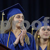 MIKE SPRINGER/Staff photo<br /> Honors graduates Zoe Nepomnayshy, left, and Jessica Shay applaud during the presentation of the Distinguished Citizen award to retiring West Elementary School president Liz Roos during the 2019 Andover High School graduation ceremony at the Tsongas Center in Lowell.<br /> 6/3/2019