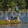 MIKE SPRINGER/Staff photo<br /> From left, Hazel Thibault, 8, Stevie Johnson, 11, and Colin MacLean, 11, take part in a fishing derby with other Webelos on Sunday at Pomps Pond in Andover. The event was the last activity in the Andover-based Pack 76 for the older kids, who are graduating to the next level of Scouting.<br /> 6/9/2019