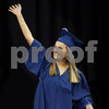 MIKE SPRINGER/Staff photo<br /> Cara Richardson waves to someone in the audience after receiving her diploma during the 2019 Andover High School graduation ceremony at the Tsongas Center in Lowell.<br /> 6/3/2019