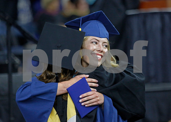 MIKE SPRINGER/Staff photo<br /> Sydney Bergan receives a congratulatory hug after receiving her diploma during the 2019 Andover High School graduation ceremony at the Tsongas Center in Lowell.<br /> 6/3/2019