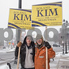 AMANDA SABGA/Staff photo<br /> <br /> Candidate for selectman Roland Kim, right, holds signs with supporter Jacob Rich on Main Street in downtown Andover.<br /> <br /> 3/2/19