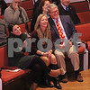 MIKE SPRINGER/Staff photo<br /> Andrew Lloyd Harris's wife, Ally Mazzarella, left, of Somerville, and his parents, Kerianne and Ted Harris of Andover, laugh during a light moment in his ordination ceremony Sunday at South Church in Andover. <br /> 11/10/2019
