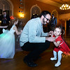 CARL RUSSO/Staff photo. Adam Parsch of North Andover dances with his daughter, Lucy, 2 at the Holly Ball. <br /> <br /> The annual holiday Holly Ball dance sponsored by Andover Recreation was held Friday night (11/22) at the the Old Town Hall. (Town House) Little girls wearing their special holiday dresses were escorted by their fathers or Grandfathers or uncles. Mike Pride entertainment provided the music and games while refreshments were served. 11/22/2019