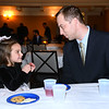 CARL RUSSO/Staff photo. Alex Balford of North Andover and his daughter London, 4 take a break from dancing to enjoy some cookies. <br /> <br /> The annual holiday Holly Ball dance sponsored by Andover Recreation was held Friday night (11/22) at the the Old Town Hall. (Town House) Little girls wearing their special holiday dresses were escorted by their fathers or Grandfathers or uncles. Mike Pride entertainment provided the music and games while refreshments were served. 11/22/2019